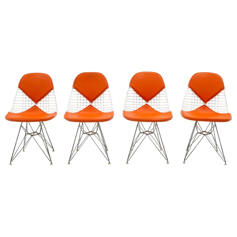 Four Eames White Wire DKR Dining Chairs, Eiffel Tower Base, Orange Bikini Covers For Sale