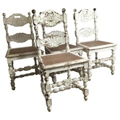 Four Early 19th Century French Carved Oak Dining Chairs