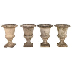 Four Early 20th Century Composition Stone Urns