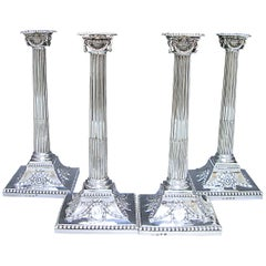 Four elegant George III Antique Silver Candlesticks