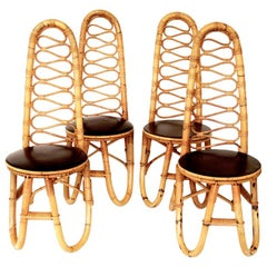 Four French Bamboo and Rattan French Riviera Sculptural Dining Chairs circa 1970