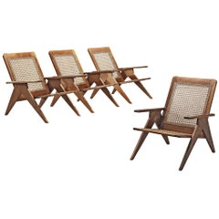 Four French Lounge Chairs in Cane and Mahogany