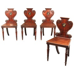 Four George IV Armorial Hall Chairs