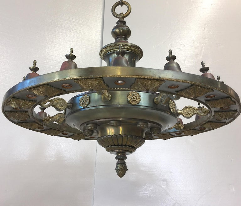 We have four of these large bronze and brass chandeliers which graced the lobby of the Malden Trust Company bank at 94 Pleasant Street Malden, MA since 1913. The architect was Theodore C. Visscher of NY together with prominent bank builders, Hoggson