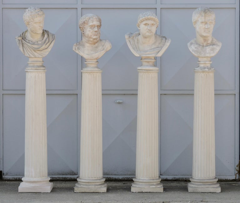 A set of Grand Tour 19th century four Romans Emperors busts on columns in plaster, circa 1870. Columns H 125 cm 49.21 in.