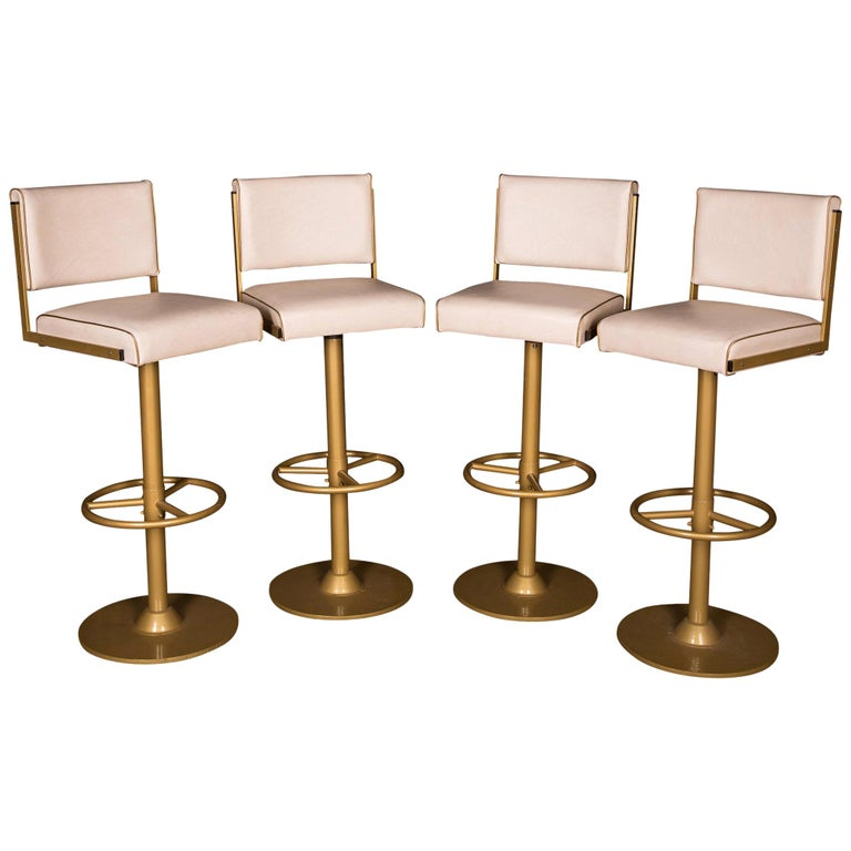 Four High Quality Bar Stools Made of Metal in Golden Color For Sale