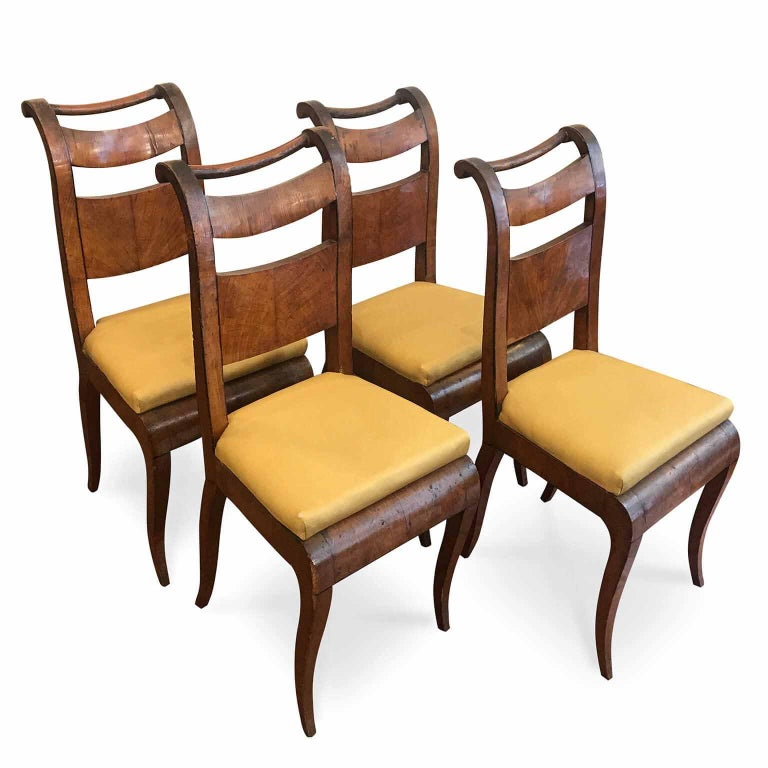 Four 19th century Directoire Genoese maple chairs, a group of four Ligurian chairs, maple veneered marked inside the structure with initials VB Maple, to be restored. The edge of the backrest is decorated with an ebony profile, of Ligurian origin,