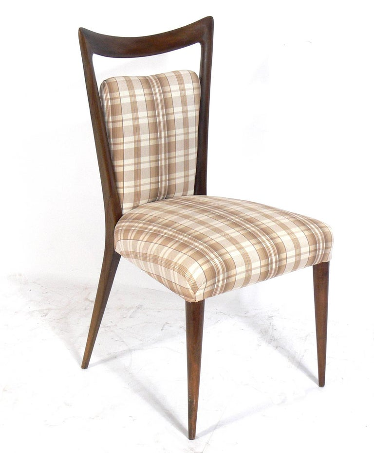 Set of four Italian modern dining chairs, designed by Melchiorre Bega, Italian, circa 1950s. These chairs are currently being refinished and reupholstered. The price noted below includes refinishing in your choice of color and reupholstery in your