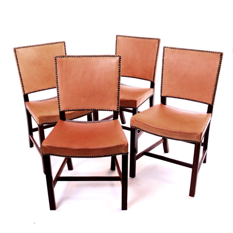 Kaare Klint & Rud Rasmussen - Mid-Century Modern design/ Scandinavian Modern  A set of four of the icomic Kaare Klint 'Red Chairs' or 'Barcelona Chairs'.  Profiled legs of mahogany, seat and back upholstered with patinated vegetable leather and