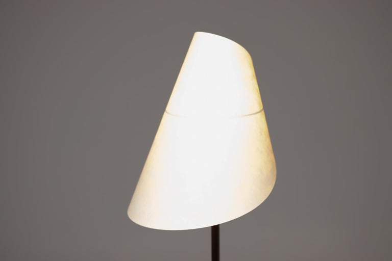 Elegant table lamp made by Nemo Cassina. Steel frame in grey, lampshade in white composite material. Italy, 1973. Marked with label. 4 available, priced individually.  References:  Domus n. 754-755, 1993, p. 133; Domus n. 671, April 1986, p.