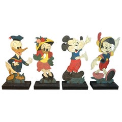 Four Large Mid-Century Disney Figures Donald, Daisy, Micky Mouse And Pinocchio