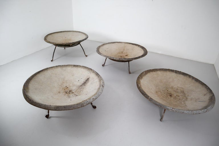 A set of four Mid-Century Modern large saucer planters of composition stone for an indoor or outdoor garden, garden room, or terrace, designed by the iconic Willy Guhl in the early 1960s. They have a lovely naturally-weathered surface.  Price is