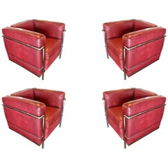 Four LC2 Lounge Chairs Reupholstered in Burgundy Leather, Italy, circa 1970