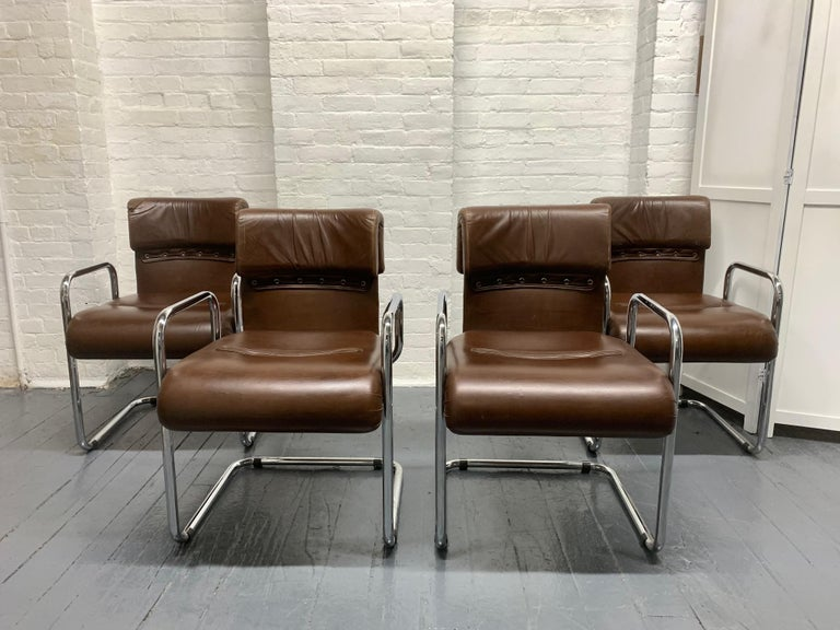 Four leather and chrome chairs designed by Guido Faleschini for Mariani, Pace collection. 