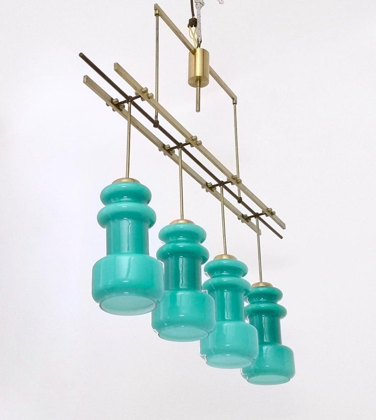 Mid-20th Century Four-Light Chandelier by Stilnovo with Turquoise Glass Lampshades, Italy 1950s For Sale