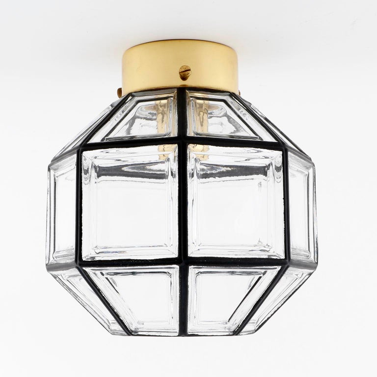 One of four beautiful and unique design 'iron' glass lights by Glashütte Limburg, Germany, manufactured in midcentury, circa 1970 (late 1960s or early 1970s). It can be used as wall or ceiling lamp. Black iron circles inlaid in thick clear glass.