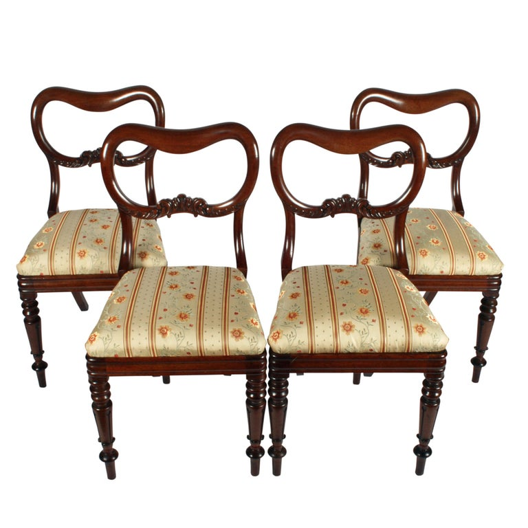 Four Mahogany 'Kidney' back chairs.   A fine set of four mid-19th century mahogany dining room chairs.  The chairs have 'kidney' shaped backs with a centre rail of carved acanthus and the legs are turned and fluted to the front and square to