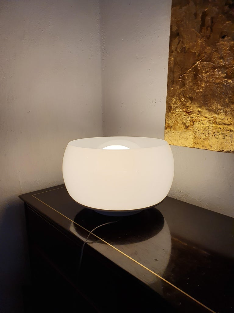Flush mount or plafonnier designed by Vico Magistretti for Artemide, circa 1960 in opaline glass and white (cream) lacquered hardware. Four lights available.