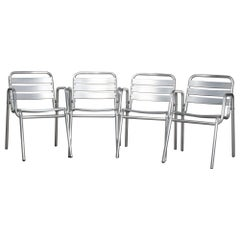 Four Mid-Century Modern Stacking Aluminum Banded Armchairs, circa 1960