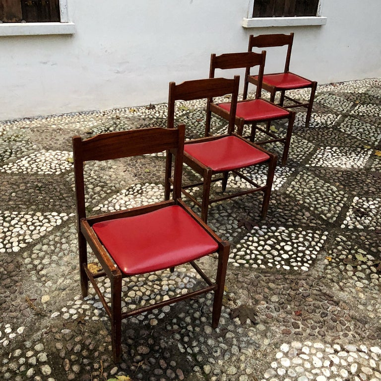 Set of 4 dining chairs designed by Gianfranco Frattini in the 1960s.