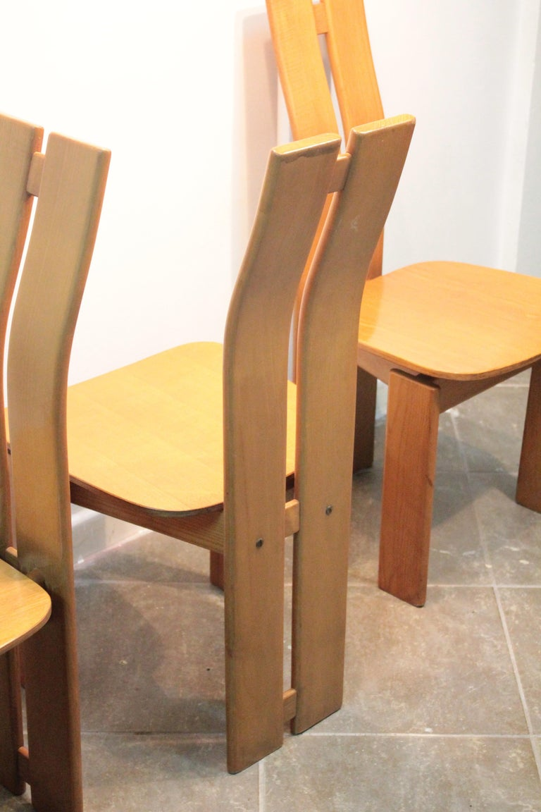 Four Italian wood chairs in the style of Afra and Tobia Scarpa 1970 circa. Good vintage condition. The curved back design and the plywood seat make these chairs a true piece of technical design.