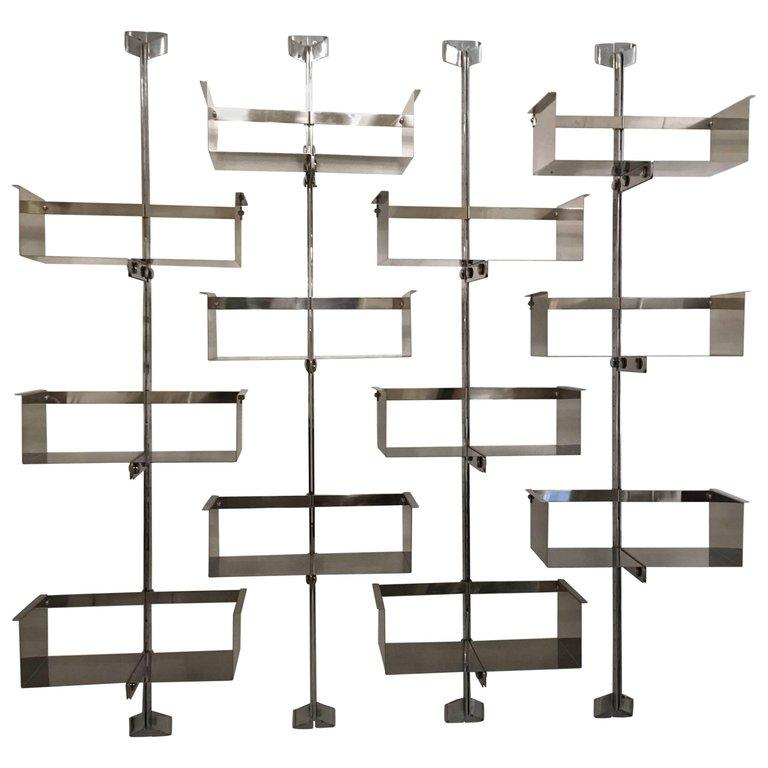 Four modular wall-mounted shelving system designed by Vittorio Introini, produced by Saporiti, Italy, circa 1969. Stainless steel, very good condition.  Shelves can be used individually or combined together in many different ways 4 shelves for each