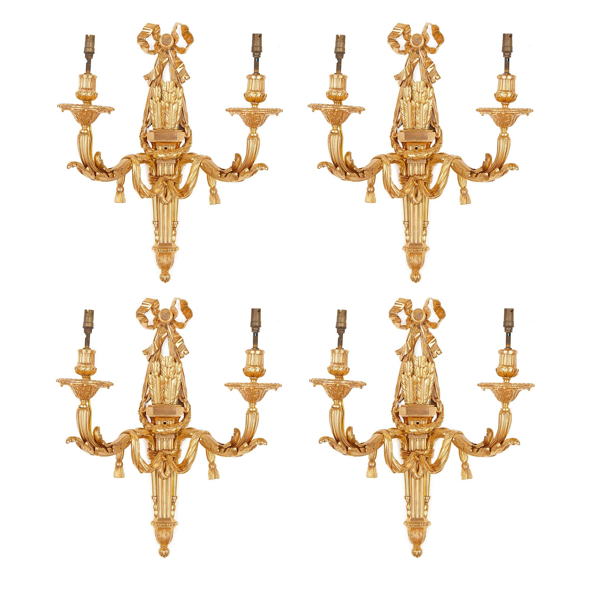 Four Neoclassical Style Gilt Bronze Two-Light Sconces