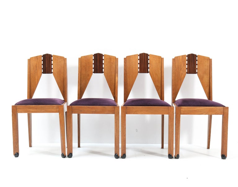 Wonderful set of four Art Deco Amsterdam School chairs. Design by J.J. Zijfers Amsterdam. Striking Dutch design from the 1920s. Soild oak and solid macassar ebony and macassar ebony veneer. Re-upholstered with purple velvet fabric. In very good