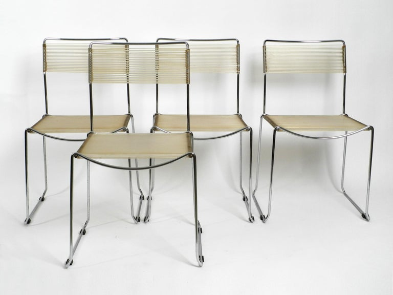 Four very rare original 1970s Spaghetti chairs with chromed frames  and light beige transparent straps. Made in Italy. Beautiful Minimalist Italian design of the Pop Art era. Very well preserved with very few signs of wear. All four chairs are