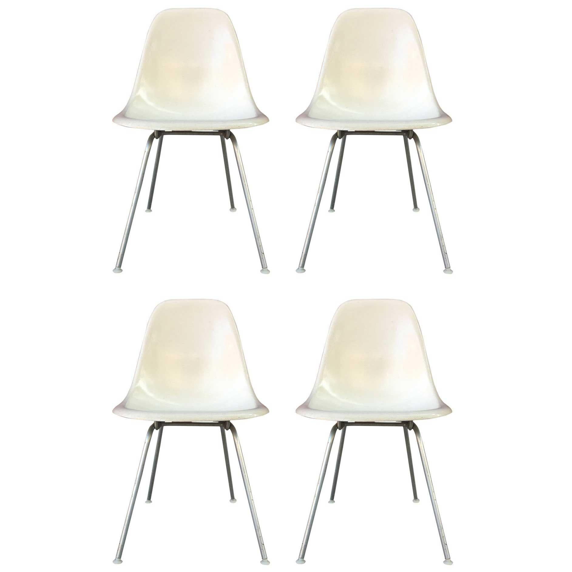 Four Parchment Herman Miller Eames Dining Chairs