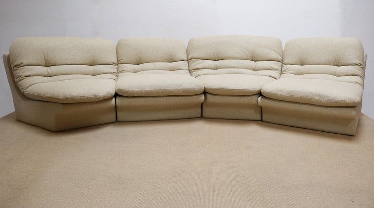 This sectional features 4 pieces: 2 slipper chairs and 2 corner chairs placed in any configuration. It has been recovered in a beautiful textured slightly silky fabric.