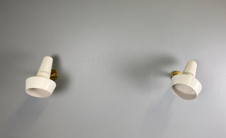 Four Stilnovo brass adjustable wall lamp, 1960s.