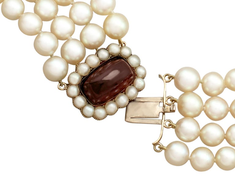 02ef99d98bca3 Four-Strand Pearl Choker with Garnet and Pearl, Yellow Gold Clasp