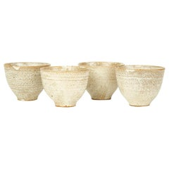 Four Studio Pottery Oatmeal Glazed Bowls, 20th Century