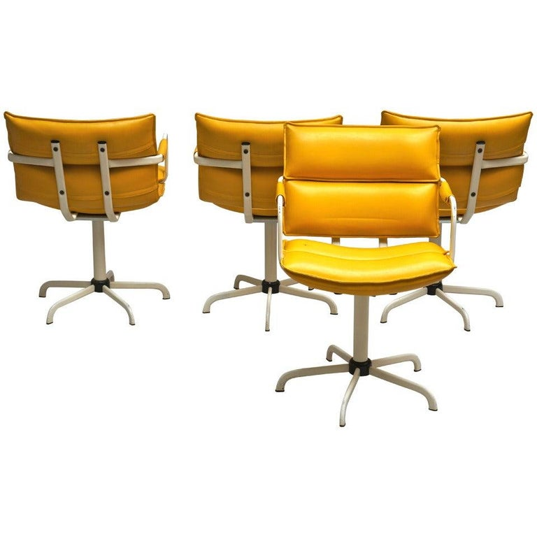 One of Four Swivel Armchairs in Yellow Leather and White Base For Sale