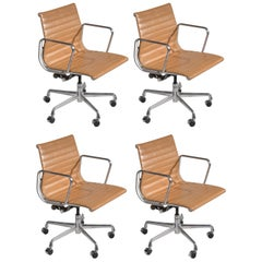 """Four Vintage Eames Aluminum Group Leather """"Management"""" Chairs in Tan Leather"""