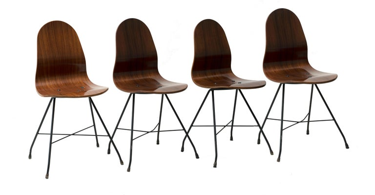 Curved teak wood veneer plywood, welded enameled metal rod.   Manufactured by Home, circa 1955.  Franco Campo and Carlo Graffi, students of Carlo Mollino, with whom they collaborate on various projects (also for the ENI of Mattei), founded in
