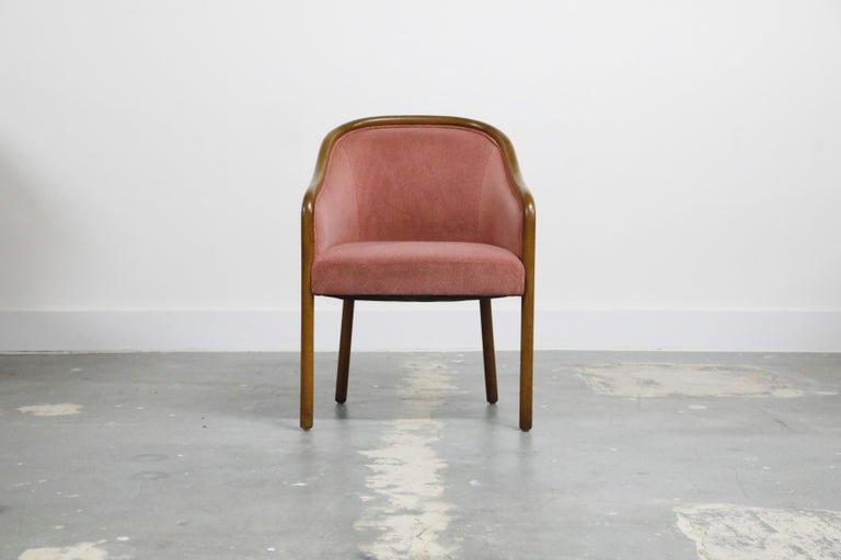 Set of four Ward Bennett dining armchairs for Brickel Associates, circa 1970s. These curvaceous arm chairs are upholstered in sumptuous pink velvet and edged in walnut and supported by walnut legs. Classic design and style, excellent option for
