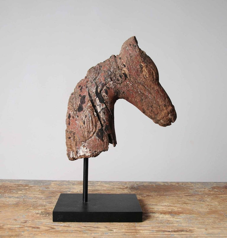 Fragment of horse head sculpture, 19th century, hand-carved from single piece of wood on later iron Stand. Carved with beautiful details of the mane and halter / bridle.