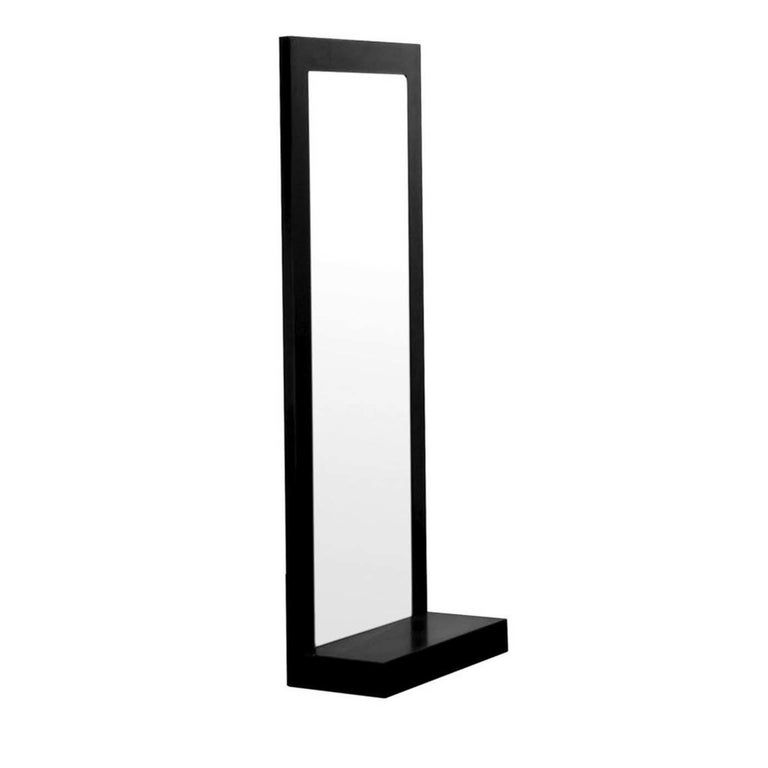 This elegant mirror designed by Maurizio Peragalli can be hung on the wall, leaned against it, or simply displayed freestanding when used with its dedicated self-supporting base. Finished with final beeswax coating to protect the surface from water