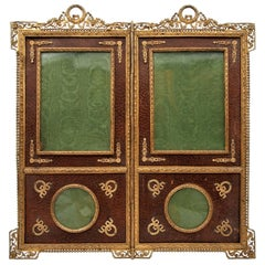 Frame Forming a Small Two-Leafed Screen in Gilt Bronze and Leather