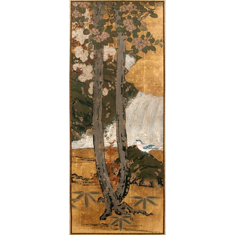 Framed Japanese landscape painting circa 1830s, the late Edo Period, possibly a panel from an antique floor screen. The painting was executed in the Rimpa style, depicting a tranquil forest scene with two towering magnolia trees in duel color