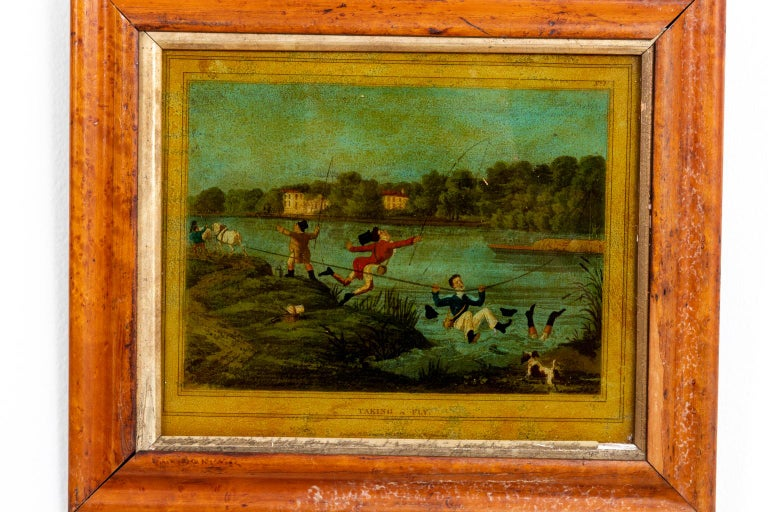 Framed English print mounted behind glass featuring a fishing scene with figures, circa 1880s. Please note of wear consistent with age including minor wear and slight damage to frame. There is also evidence of restoration to one frame.