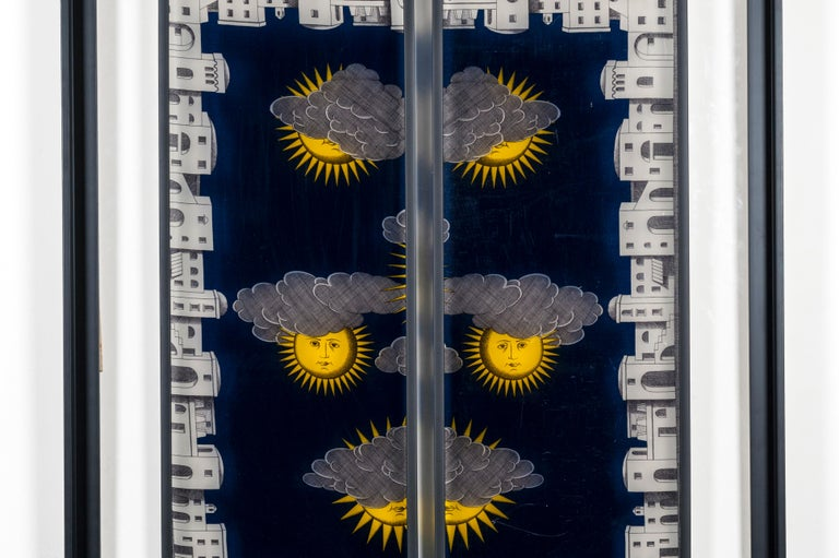 These serigraphied panels made by Fornasetti are mounted on an altuglass with a steel frame.