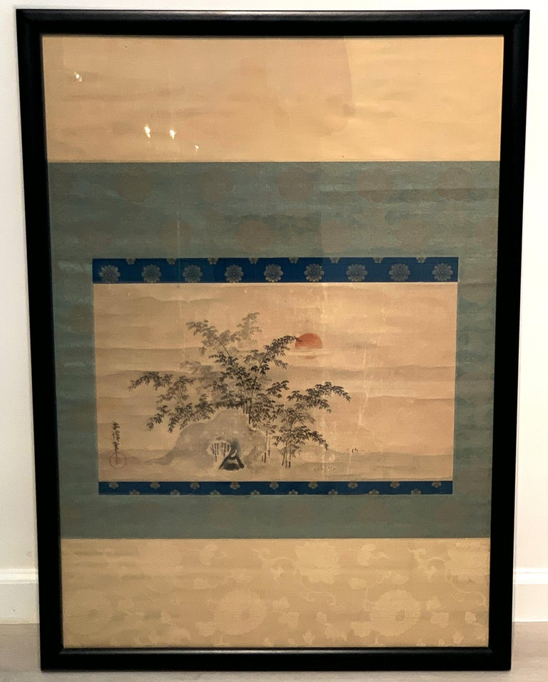 A charming Japanese sumi-e ink and color scroll painting, mounted, framed and glazed, signed Yasunobu, late Edo or early Meiji Period, mid-19th century.  The scroll painting depicting a stand of soaring bamboo behind a natural rock formation. In