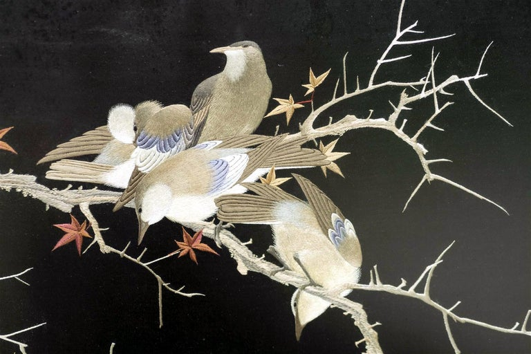 An exquisite Japanese embroidery piece circa end of 19th century-early 20th century of Meiji period. The poetic composition of three birds perched on the branches of the maples in deep autumn, evokes a strong sense of seasonal beauty that is