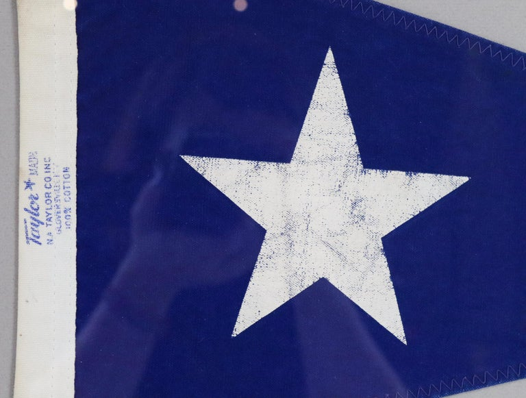 Framed nautical pennant, navy blue burgee flag with white star by Taylor. 100% cotton. Nicely framed. Measures: 22