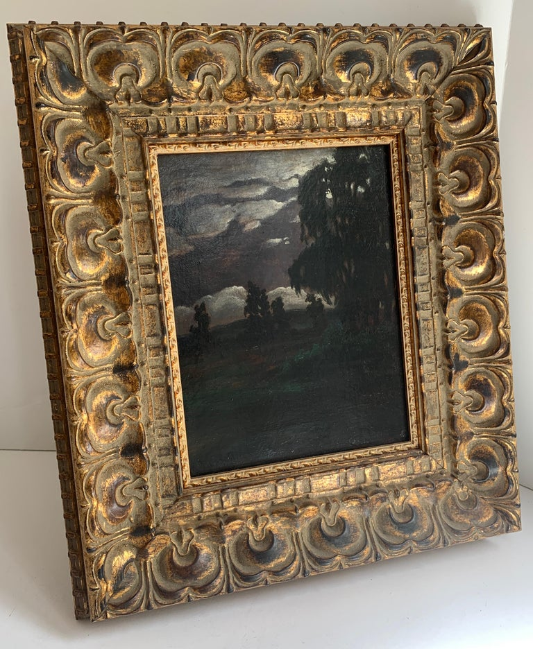 Oil on canvas dark landscape by R. Russell, dated 1915. A wonderfully moody painting of a landscape with sky.  The darkness can be altered by the amount of light that enters the room, however, in our gallery the painting is very dark, leaving the
