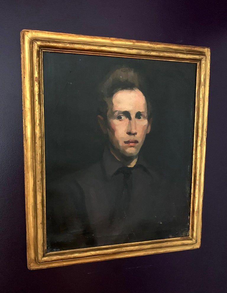 An oil painting depicting an unidentified young man by George Wesley Bellows (1882-1925), a member of American Ashcan School in the circle of Robert Henri. This portrait is in its original condition with the period frame. Signed G.Bellows BR on