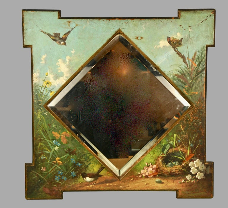 A charming American Victorian mirror, the original centered beveled glass mirror plate surrounded by well-painted images of nesting and flying small birds, butterflies and various wildflowers. The overall composition, a verdant garden scene with a